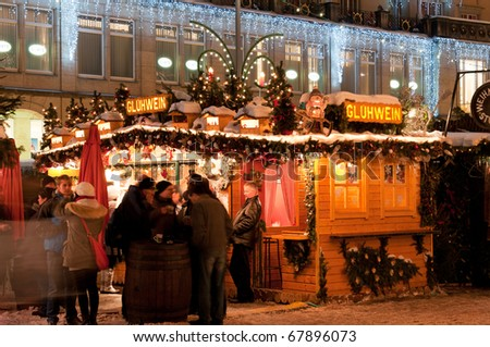 DRESDEN, GERMANY - 20 DECEMBER: Group of people enjoy Christmas market in Dresden on December 20, 2010. It is Germany's oldest Christmas Market with a very long history dating back to 1434. - stock photo
