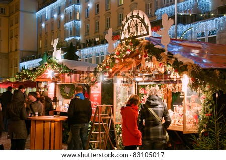 DRESDEN, GERMANY - DECEMBER 20: People enjoy Christmas market in Dresden on December 20, 2010 in Dresden, Germany. It is Germany's oldest Christmas Market with a very long history dating back to 1434.