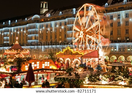 DRESDEN, GERMANY - 20 DECEMBER: People enjoy Christmas market on December 20, 2010 in Dresden, Germany. It is Germany's oldest Christmas Market with a very long history dating back to 1434.