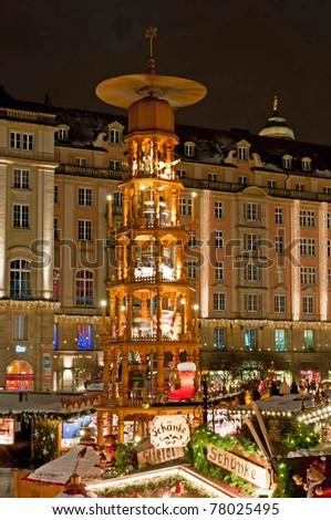 DRESDEN, GERMANY - DECEMBER 20: Traditional Christmas market in Dresden on December 20, 2010. One of the highlights is eight meter high Christmas pyramid with life size hand made wooden figures.