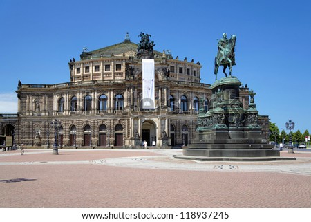 DRESDEN, GERMANY - JUNE 11: Opera House and monument to King John of Saxony on June 11, 2010 in Dresden, Germany. The Opera House was built in 1841, destroyed in World War II and rebuilt in 1985.