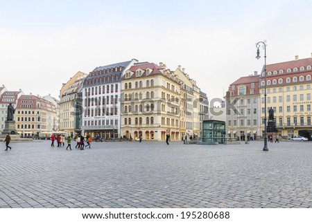 DRESDEN, GERMANY - MARCH 6, 2014: People walk on Neumarkt Square. Neumarkt square is a central and culturally significant section of the Dresden inner city.