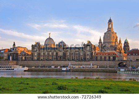 dresden skyline with river elbe and boats at sunset