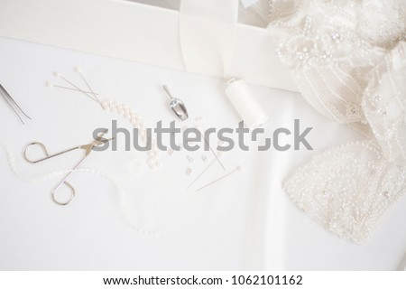 Dress making jewels and tools. Clothing alteration shop.