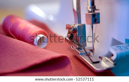dress sewing process in the phase of overstitching