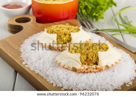 Dressed Crab / Casquinha de Siri - Spicy crab meat served in its shell on the top of sea salt. Served with chili sauce and farofa de dende.
