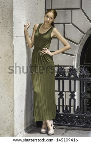 stock-photo-dressing-in-a-green-maxi-tank-dress-high-heal-shoes-a-young-fashion-black-girl-is-standing-by-a-145109416.jpg