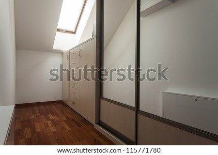 Dressing room on the attic, wardrobe, modern house