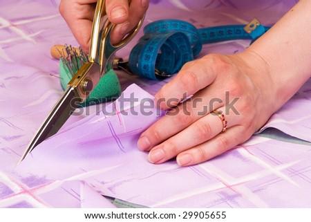 dressmaker cuts scissors fabrics - stock photo