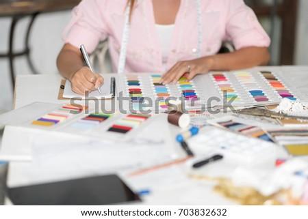dressmaker take note for Thread color Choosing. Setup studio shooting. #703832632