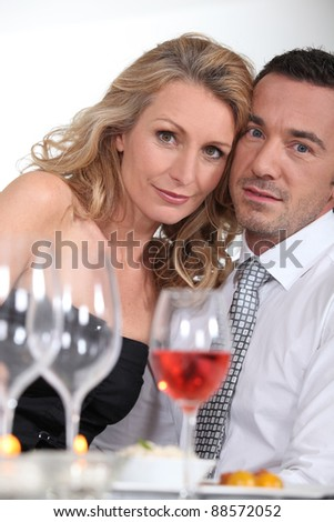 Dressy couple having dinner
