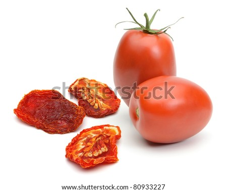 Dried and fresh plum tomatoes on white background - stock photo