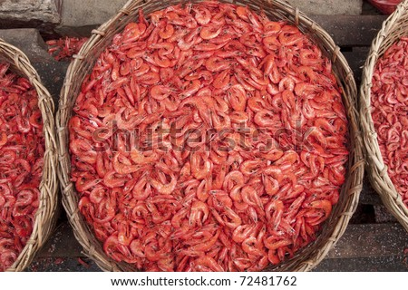 Dried and salted prawns in wicker baskets at the main market in Colombo, Sri Lanka