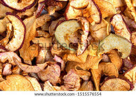 Dried apples background. chopped dried apples. Dried fruits. concept of crop preservation, winter harvesting, semi-finished products. Abstract natural background.