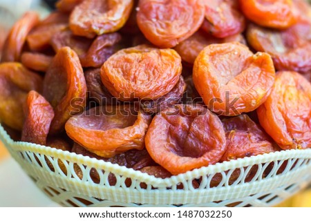 Dried apricots, dried fruits in a wicker basket.