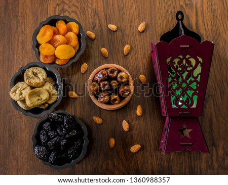 Dried Apricots,dried plums,dried fog,dates & nuts. Ramadan Background, Ramadan desserts & Muslim lamp