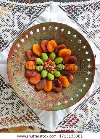 dried apricots, green apricots, apricot kernels in the bowl on the white pattern Stok fotoğraf ©