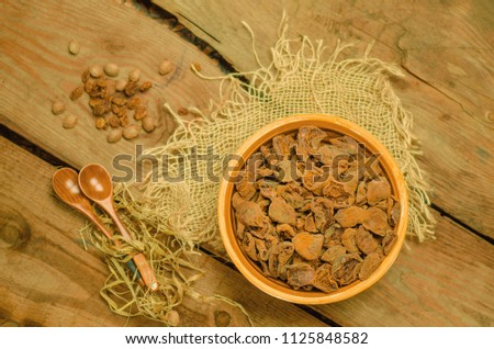 Dried apricots in bowl. Delicious dried apricots. Bowl of dried apricots. Dried apricots on wood background. #1125848582