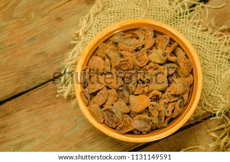 Dried apricots in bowl. Delicious dried apricots. Bowl of dried apricots. Dried apricots on wood background. Top view with copy space. #1131149591