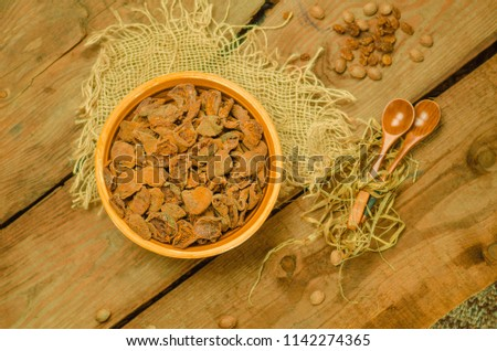 Dried apricots in bowl. Delicious dried apricots. Bowl of dried apricots. Dried apricots on wood background. #1142274365