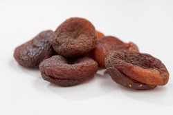 dried apricots on a white table