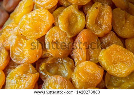 Dried apricots piled on a pile. Texture.