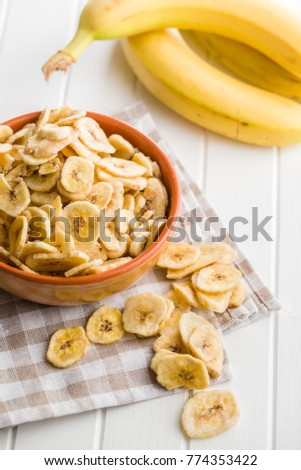 Dried banana chips on kitchen table.