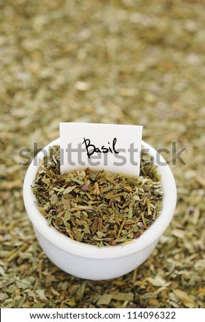 Dried basil in a white ceramic bowl