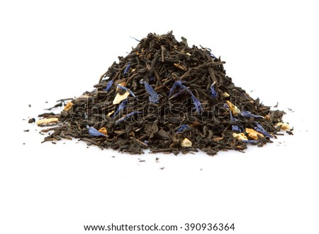 Dried black Earl Grey tea leaves over white background