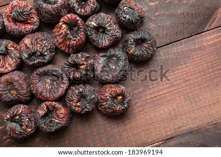 Dried black figs on a wooden surface #183969194
