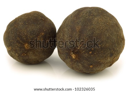 "dried ""black lime""fruit on a white background"