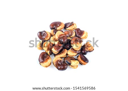 dried broad bean in spoon on white background