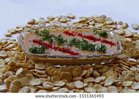 Dried broad beans and turkey fava dish on white background.