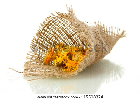 dried calendula flowers in sacking, isolated on white