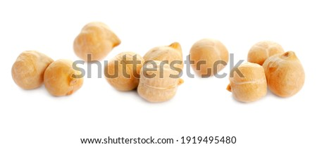 Dried chickpea beans isolated on white background, close-up. Macro photo of dried chickpeas isolated on white background. Dry grains of chickpea isolated on white background. Dry chickpeas close up.