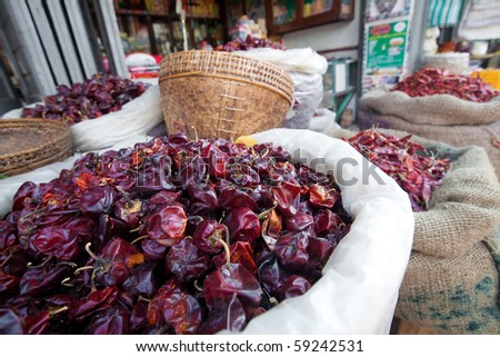 Dried chili in sacks being sold in an outdoor Asian market