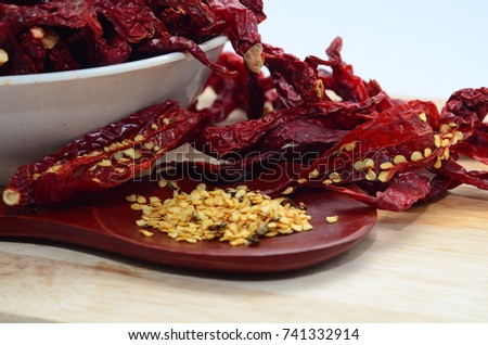 Dried Chili with chili seed on Cutting board inside the bowl #741332914