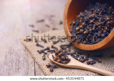 dried cloves on wooden spoon and  background. #453144871