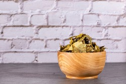 Dried coca leaves in the bowl - Erythroxylum coca