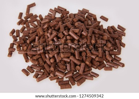 Dried corn silk, maydis stigma. Pile of granulated dry corn silk closeup isolated on white background. Medicinal plants. #1274509342
