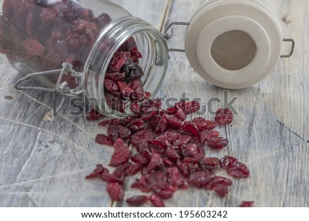 Dried Cranberries in a Jar on a wooden table