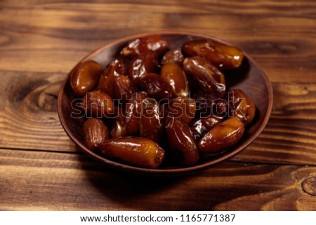 Dried dates fruit on wooden table