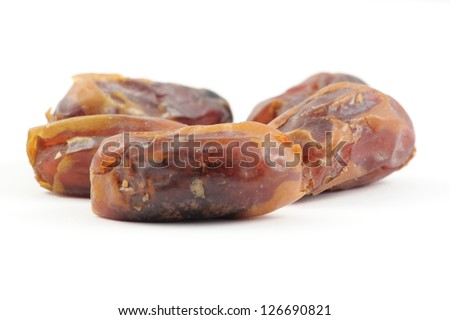 dried dates isolated on white close up in studio