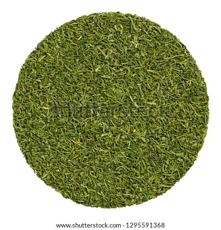 Dried dill fronds. Herb circle from above, isolated, over white.Disc made of shredded green leaves of Anethum graveolens, also called dill weed, used as herb and spice. Closeup. Macro food photo.