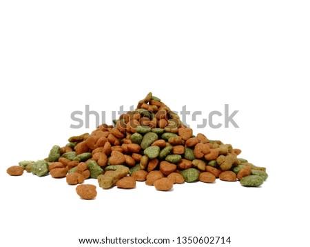 Dried dog food background .Colorful dog food, bone shape, heart shape, vegetable shape #1350602714