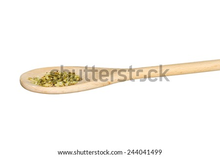 Dried fennel seeds on a wooden spoon isolated on white #244041499