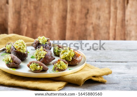 Dried figs and dried apricot stuffed with nuts, garlic and herbs paste over gold plate