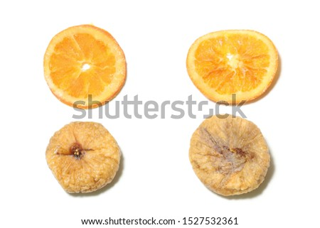 dried figs and dried oranges in a white background