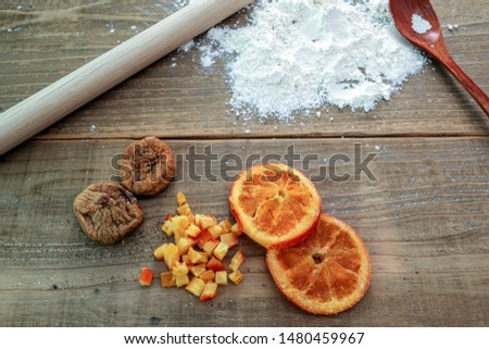 dried figs and dried oranges in a wooden background