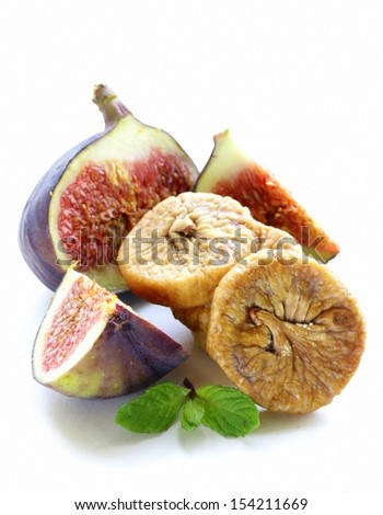 dried figs and fresh fruit on a white background